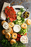 Big breakfast platter with bagels, smoked salmon and vegetables Royalty Free Stock Image