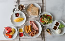 Big breakfast and some fruits Stock Images