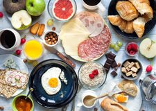 Big breakfast on the white rustic table. Stock Image