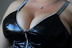 Big breasts in latex Royalty Free Stock Image