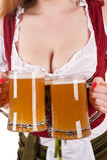 Big breasts Oktoberfest waitress with two mugs Stock Image