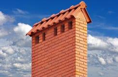 Big brick smokestack. Brick smokestack  on background of blue sky Stock Photos