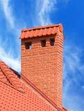 Big brick smokestack. Brick smokestack  on background of blue sky Royalty Free Stock Photo