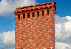 Big brick smokestack. Brick smokestack isolated on background of blue sky Stock Images