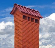 Big brick smokestack. Brick smokestack isolated on background of blue sky Stock Photo
