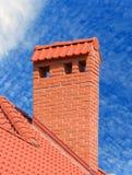 Big brick smokestack. Brick smokestack isolated on background of blue sky Royalty Free Stock Photos