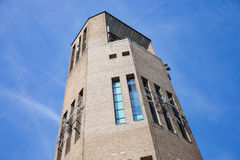 Big brick stone tower in Emmeloord, the Netherlands. Big brick stone tower with clock in Emmeloord, the Netherlands stock photo