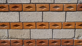 Big bricks and side orange bricks pattern texture background. One wall made of two different bricks, one of them big bricks and the other orange bricks on his stock image