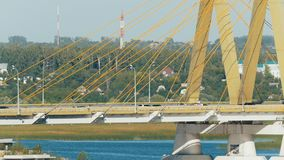 Big bridge for cars - traffic above river. Telephoto shot stock video footage