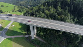 Big bridge of a highway in a nataure. Aerial shoot of a big bridge of highway road in a nature with traffic of cars and trucks stock video