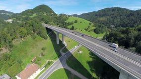 Big bridge of a highway road and motorway under the bridge. Aerial shoot of a big bridge of a highway road with traffic and motorway road under the bridge stock footage