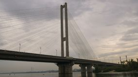 Big bridge over the river. Architectural building connecting the two banks of the city. Massive structure. A truck is stock video footage