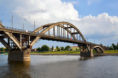 A big bridge through the river Stock Photos