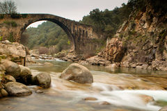 Big bridge with waterfall in Extremadura Stock Images