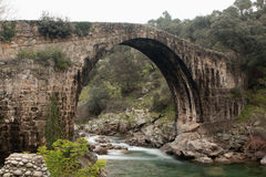 Big bridge with waterfall in Extremadura Stock Image
