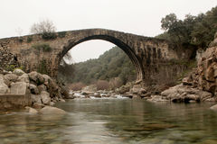 Big bridge with waterfall in Extremadura Royalty Free Stock Photo