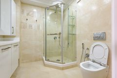 Bright bathroom interior with glass shower and toilet stock photos