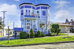 Big bright blue house with american flag. Light blue house with entrance porch view Stock Image