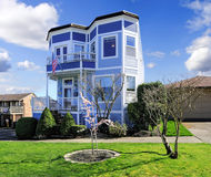 Big bright blue house with american flag. Light blue house with entrance porch view Royalty Free Stock Photos