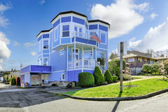 Big bright blue house with american flag. Light blue house with entrance porch view Stock Photo