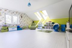 Big and bright child room at the attic Stock Images