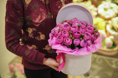 Big bright pink roses bouquet in round box. With lid Stock Photography
