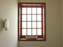 Big bright window with a basket Royalty Free Stock Images