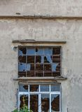 Big broken window glass on abandoned building and cracked glass. Natural background Stock Images
