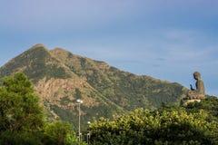 The Big Bronze Buddha statue with Lantau Peak royalty free stock photo