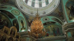 Big bronze chandelier in cathedral christian church. Big bronze chandelier in cathedral christian church stock video