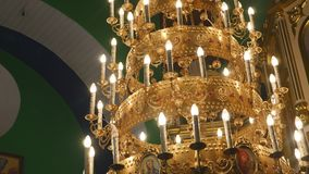 Big bronze chandelier in cathedral christian church, close-up.  Royalty Free Stock Photos