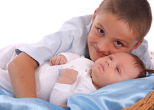 Big brother cares of the baby 2 Stock Photo