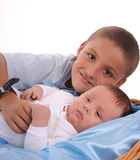 Big brother cares of the baby Royalty Free Stock Image