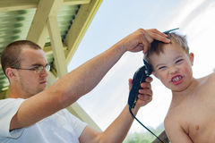 Big Brother Giving Little Brother a Haircut Royalty Free Stock Photography