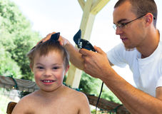 Big Brother Giving Little Brother a Haircut Stock Photos