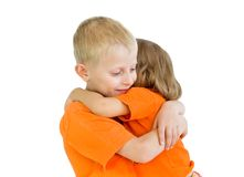 The big brother has embraced younger sister. A white background Royalty Free Stock Images