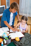 Big brother helping little girl Stock Photos