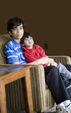 Big brother holding his younger sibling. Big brother holding his younger disabled sibling Royalty Free Stock Images
