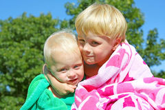 Big Brother Hugging Baby Outside Stock Images