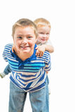 Big Brother And Little Brother Getting Along During Playtime Stock Photography