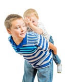 Big Brother And Little Brother Getting Along During Playtime Royalty Free Stock Photography
