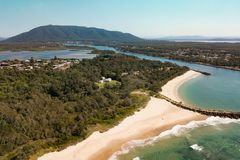 Big Brother. North Brother mountain looks down over Laurieton, Dunbogan and Camden Head. The foreground shows Wash House and Pilots beaches and the Camden Haven Royalty Free Stock Images