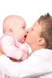 Big brother's hug and kiss. Boy and baby girl Stock Photo