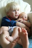 Big Brother Snuggling Baby Sister Stock Images