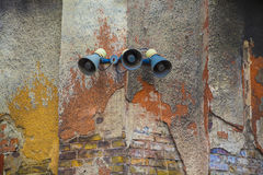Big brother talking. Megaphone installation from communist time in idustrial zone in budapest in hungary on colored weathered wall Stock Photos