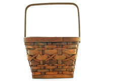 Big brown basket. Big brown wicker basket, used to carry food for picnics and such Royalty Free Stock Image
