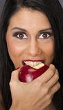 Big Brown Eyed Woman Eats Food Fruit Red Delicious Apple royalty free stock photo