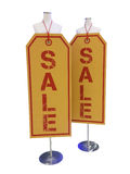 Big Brown SALE tag sign hanging on the stand Royalty Free Stock Photography
