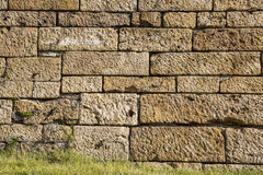 Big brown sand stone wall texture Royalty Free Stock Images