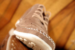 Big brown shoe.Isolated on wood colour Royalty Free Stock Photography